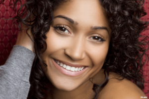 Woman with smooth skin smiling