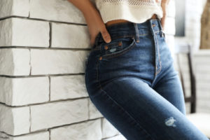 Person with a slim body wearing jeans