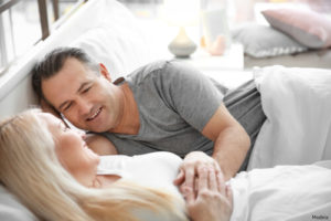 Man and woman laying in bed together
